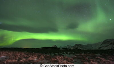 Time lapse recording of beautiful northern lights over east Iceland