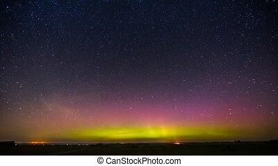 Northern lights timelapse in the night sky