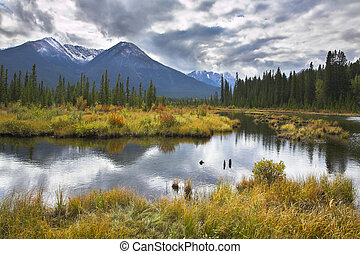 Northern mountains of Canada - Fine ripples on cold lake of...