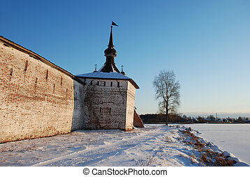 Photo of the Kirillo-Belozersky monastery in a winter landscape at sunset. Vologda region, Russia.