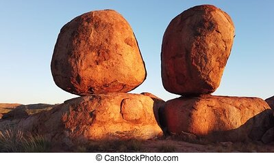 Popular and iconic Devils Marbles: Eggs of mythical Rainbow Serpent at sunset. Karlu Karlu - Devils Marbles is one of Australia's most famous natural wonders in Northern Territory, Outback Red Centre.