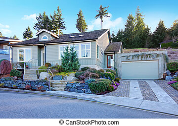 Northwest tile roof small house with a beautiful flowerbed -...