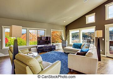 Northwest traditional large bright living room interior. -...