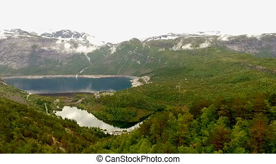 Norway. beautiful landscape of Norway. Blue lake in the background of mountains and forests