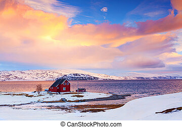 Norway in winter: mountains with colorful houses and the...