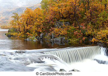 norway  - waterfall in the autumn woods, norway