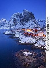 Norwegian fisherman's cabins on the Lofoten at dawn in winter