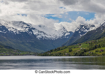 norwegian fjord with moutains and water