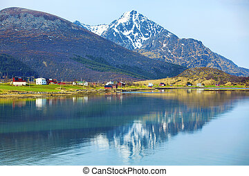 Norwegian fjord - Snowcapped mountains and blue water,...