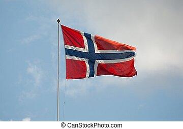 Norwegian Flag - Norwegian flag waving against blue sky