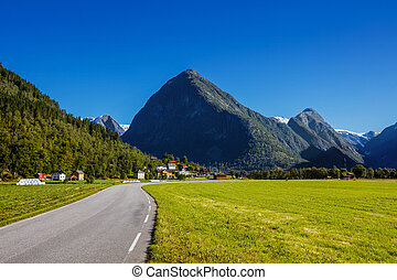 Norwegian landscape with road and green mountains. Norway