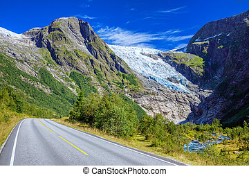 Norwegian landscape with road, glacier and green mountains. Norway