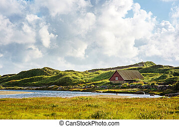 Norwegian landscape with small house