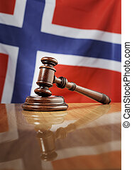Norwegian Law - Mahogany wooden gavel on glossy wooden...