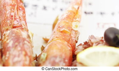 Norwegian lobster with rice - On a dish with hieroglyphs...