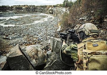 Norwegian machine gunner among the rocks
