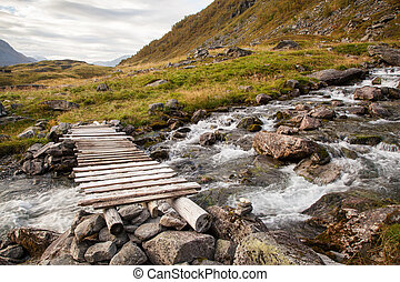 Norwegian mountain autumn landscape with bridge near Geiranger