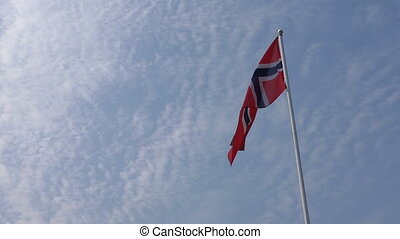 Norwegian Norway flag - Flag of Norway blowing in the sky on...