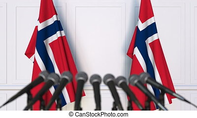 Norwegian official press conference. Flags of Norway and...