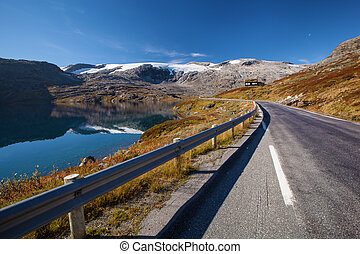 Norwegian road in mounrtains in autumn