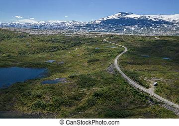 Boondocking Camper Camping in the Norwegian Nordland Territory Saltfjellet-Svartisen National Park. Aerial Scenic Summer Landscape.