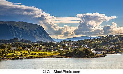 Norwegian village in fjord landscape