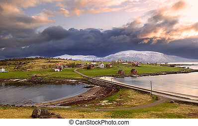 Norwegian village in the mountains with a gloomy sky