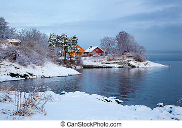 Norwegian winter fjord landscape with colorful houses
