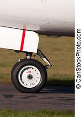 Nose landing wheel of a modern jet airliner close up
