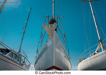 nose of white sailboat in the port - nose of white beautiful...
