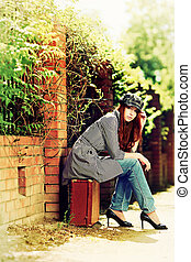 nostalgia - Beautiful young woman with old suitcase walking...