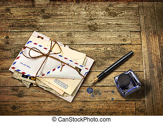Nostalgic airmail letters with ink bottle and fountain pen