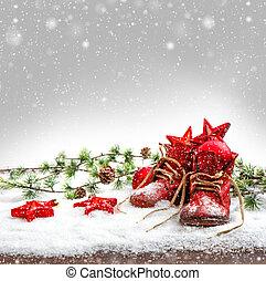 nostalgic christmas decoration with antique baby shoes. ...
