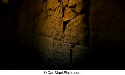 nostalgic stone wall with golden lights at night.
