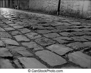 nostalgic street with cobble stone in black and white retro ...