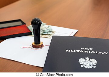 Notarial act signed by the notary and Polish money