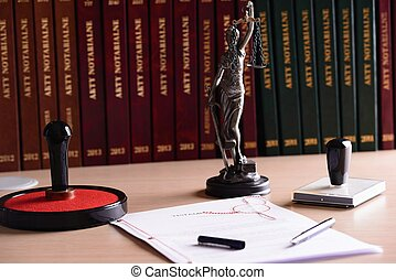 Notary public accessories. Themis with scales of justice and...