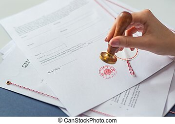 Notary public authorizing document with hers notary stamper