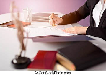 Notary Public notarizes the document. Law office concept.