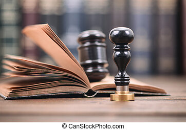 Notary seal and Judge Gavel on the wooden background,...