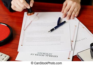 Notary's public hands stamping power of attorney. Notary...