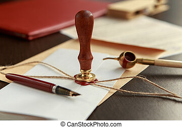 Notary's public pen and stamp on testament and last will....