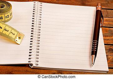 notatnik, centymetr, pióro