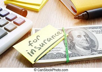 note, à, mot, pour, assurance, sur, a, pile, de, argent.