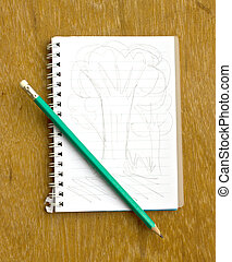 note and pencil on wooden board(Tree sketch)