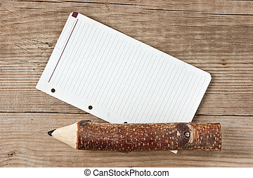 note and wooden pencil