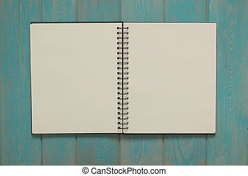Note book on blue wooden desk.