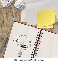 note book with hand drawn light bulb and THINK word design as concept
