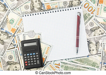 Note book with pen, coin and calculator on the background of