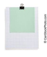 note checked paper and clip on white